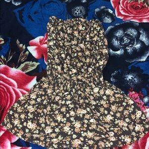 Black floral pattern romper